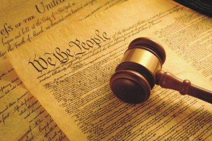 An image of the U.S. Constitution and gavel
